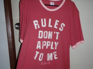 T-shirt reads: 'RULES DON'T APPLY TO ME' | Tacky Harpers's Cryptic Clues