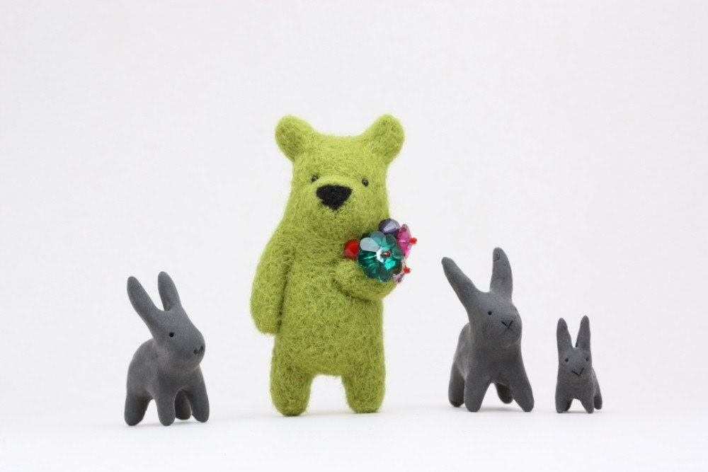 An olive green bear with crystals in paw, brooch