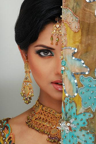 Gorgeous Indian woman in exquisite attire and gold jewelry