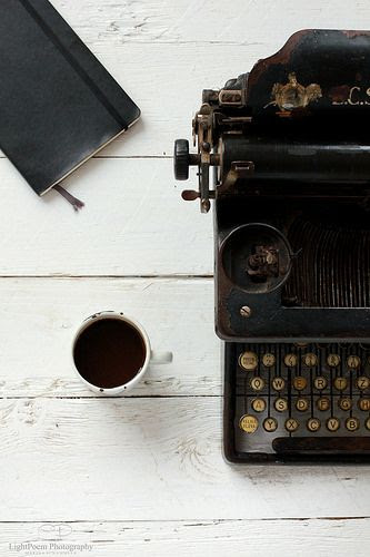 moleskine, black coffee and a vintage typewriter