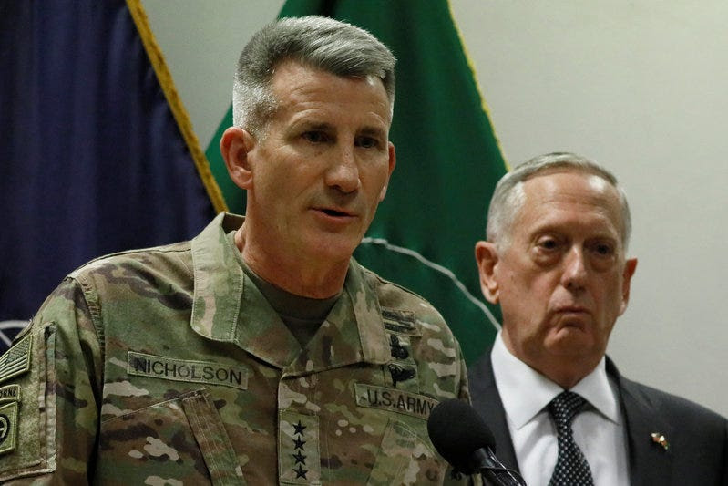 U.S. Army General John Nicholson (L), commander of U.S. Forces Afghanistan, and U.S. Defense Secretary James Mattis (R) hold a news conference at Resolute Support headquarters in Kabul, Afghanistan April 24, 2017. REUTERS/Jonathan Ernst