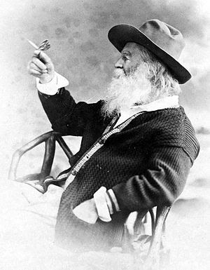 Photo of American poet Walt Whitman holding a ...