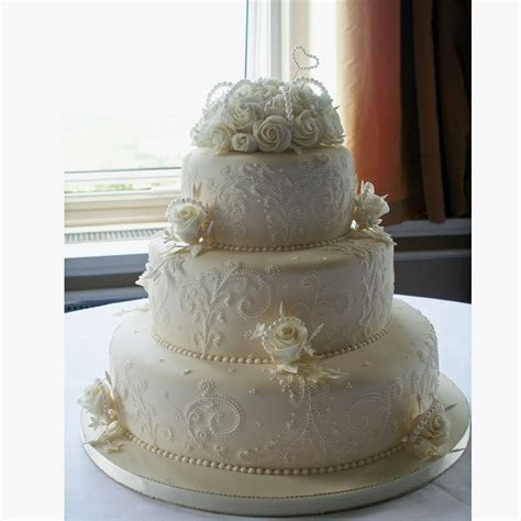 Pearl Wedding Cake decorated with detailed lace embroidery