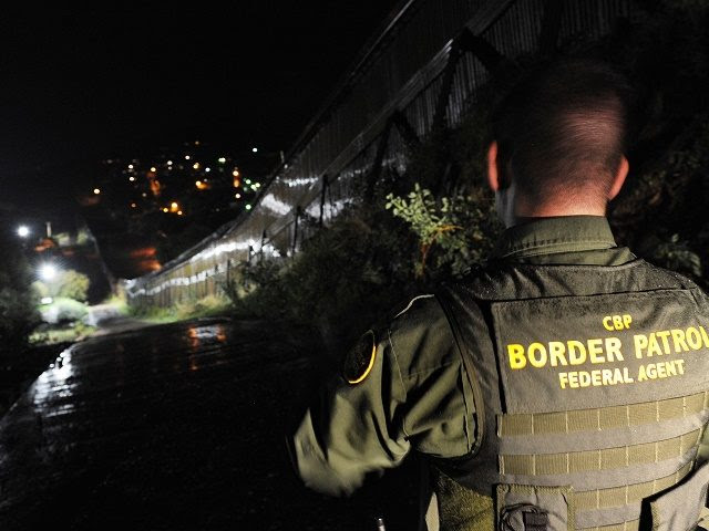 US Border Patrol agent Richard Funke patrols along the border fence between Arizona and Mexico at the town of Nogales on July 28, 2010.  A federal judge blocked the most controversial parts of Arizona's new immigration law, barring police from checking the immigrant status of suspected criminals. The ruling came hours before the new law had been due to go into effect, handing temporary victory to civil rights groups and the Obama administration which has challenged the legislation. For the first time in the United States -- a nation built on generations of immigrants -- the law would make illegal immigration a crime and penalize anybody helping or giving work to undocumented workers.                AFP PHOTO/Mark RALSTON (Photo credit should read MARK RALSTON/AFP/Getty Images)