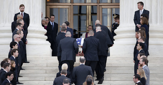 Supreme Court family pays respects to Justice Antonin Scalia