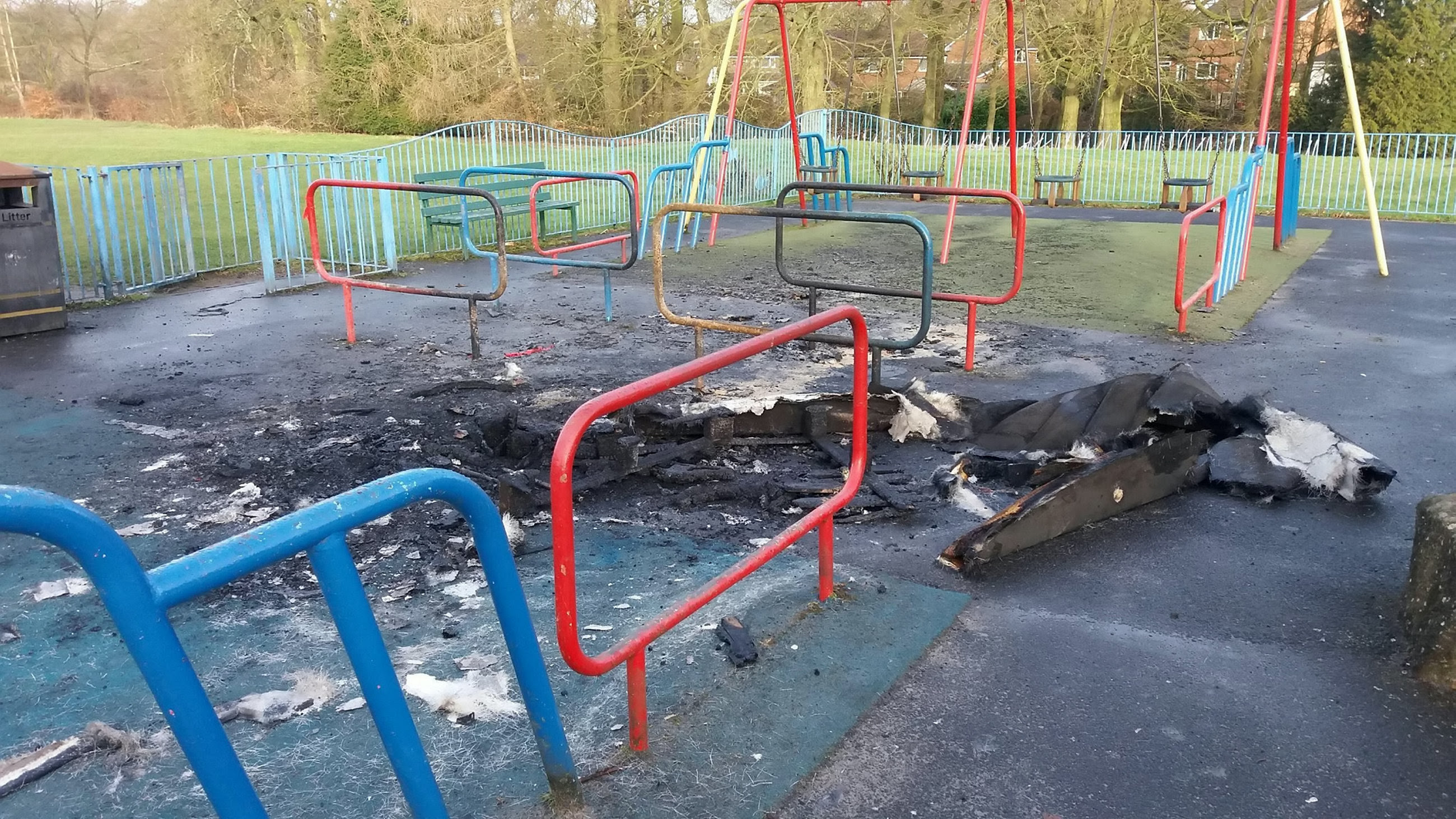Remnants of a fire at Longsight Park, Bolton. Credit: SWNS