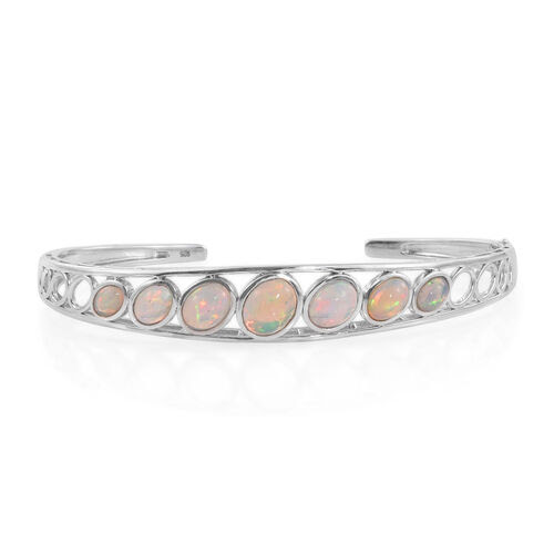 Ethiopian Welo Opal (Ovl) Bangle (Size 7.5) in Platinum Overlay Sterling Silver 4.500 Ct.