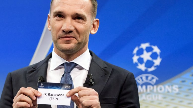 Former Ukrainian soccer player Andriy Shevchenko, ambassador of the UEFA Champions League final in Kiev, shows the ticket of FC Barcelona during the draw of the UEFA Champions League 2017/18 quarter final soccer matches at the UEFA Headquarters in Nyon, Switzerland, 16 March 2018. EPA, JEAN-CHRISTOPHE BOTT