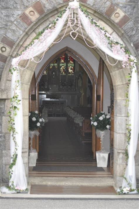 Tulle wedding arch with pearls an ivy..   Fiona & Rue's