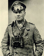 Rommel in North Africa with his signature trench coat and field glasses, circa mid-1941