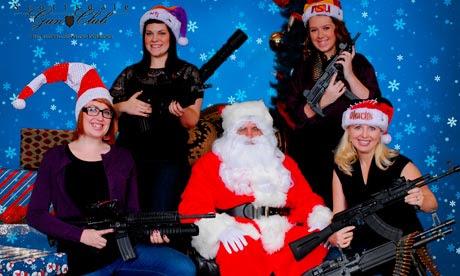 Scottsdale Gun Club members posing with Santa Claus and several guns