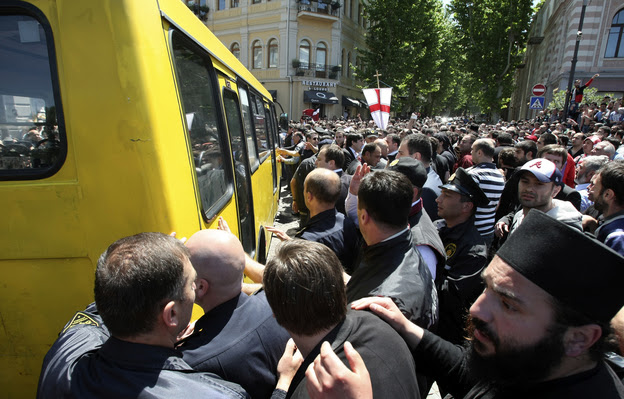 Anti-gay protesters try to attack a bus with gay activists who are being taken away from a pro-gay-rights rally by police for their own protection in Tblisi, Georgia, on May 17. Thousands of anti-gay protesters, including Orthodox priests, occupied a central street in Georgia's capital.