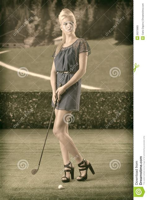 blonde girl pays golf   vintage style stock