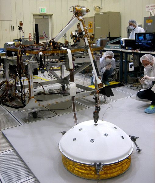 Engineers at Lockheed Martin test the robotic arm of NASA's InSight lander...set to launch towards Mars on March 4, 2016.