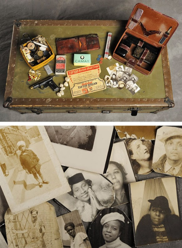 Abandoned suitcase with old family photographs, buttons, wallet, and Camay soap.