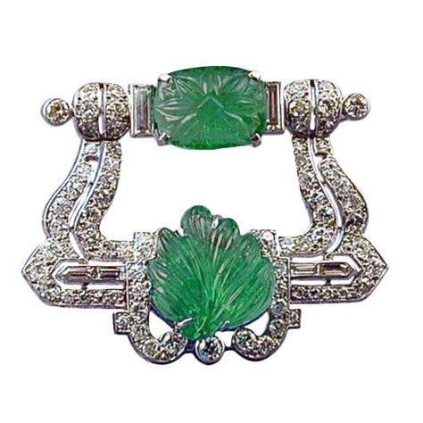 CARTIER Art Deco Carved Emerald and Diamond Brooch at 1stdibs