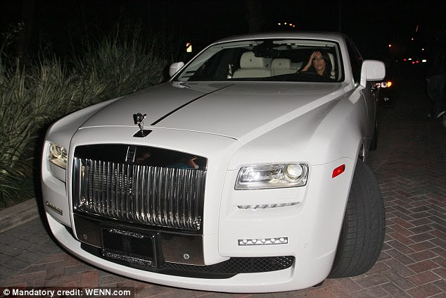 Another from the archive: Kim in her brand new $300,000 Rolls-Royce Ghost in December 2010