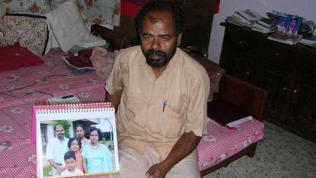 Mr Paramesvaran with photo of his children aged five, nine and 12 who died when the deadly tsunami hit Nagapattinam in Dec 2004