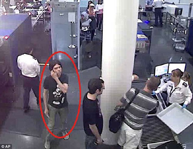 CCTV: Interpol issued this undated photo of Magnotta passing through an unnamed airport security checkpoint. After the unsuccessful raid on Saturday, police do not know his whereabouts