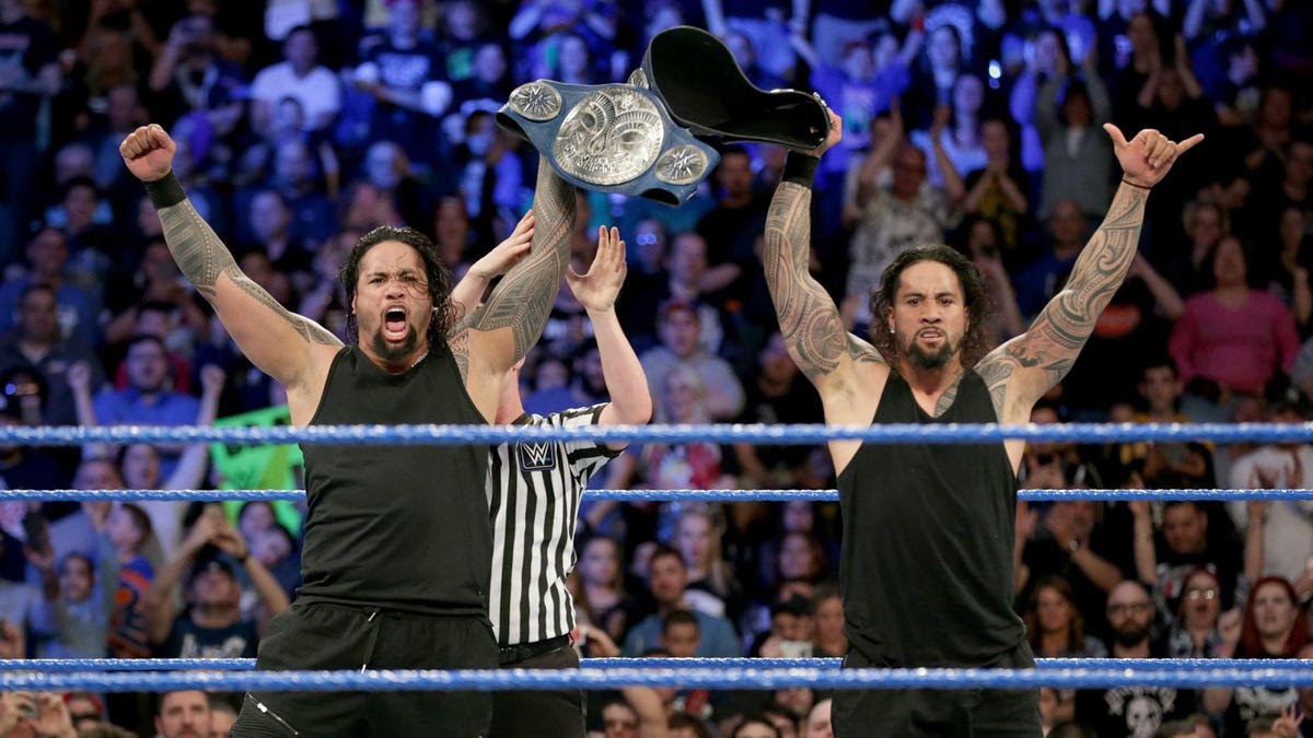 The Usos celebrate after claiming the titles from their longstanding rivals.