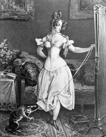 Woman in Corset with Cat Toying at Her Ribbon