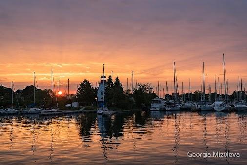 Artist's Description Vivid Yacht Club Sunrise – The boats and the #lighthouse at #Etobicoke Yacht Club...