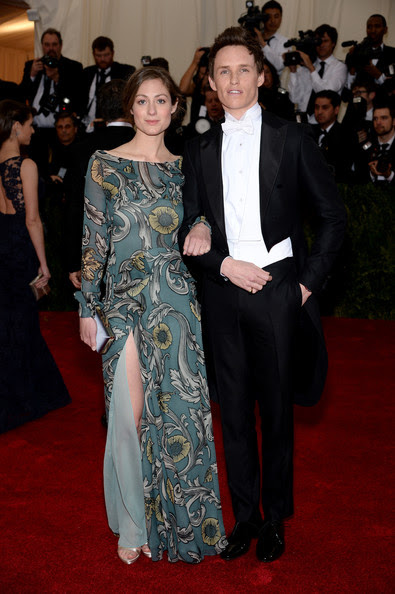 "Eddie Redmayne (R) and Hannah Bagshawe attend the ""Charles James: Beyond Fashion"" Costume Institute Gala at the Metropolitan Museum of Art on May 5, 2014 in New York City."