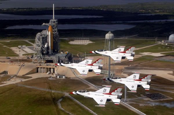 The U.S. Air Force's Thunderbirds fly over Endeavour at its launch pad to commemorate NASA's 50th anniversary.  The flyby took place around 7:15 AM, PST, today.