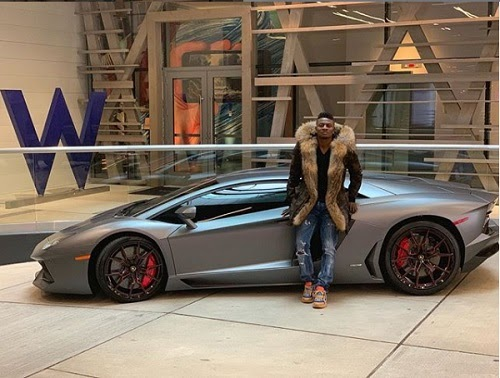 Nigerian Footballer, Obafemi Martins Shows Off His New Ferrari Spider