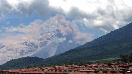 A photograph taken from a mobile phone shows plumes of ash rising from the Fuego Volcano