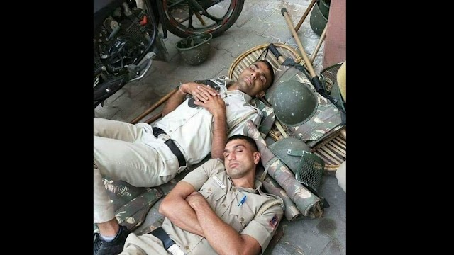 #CovidWarriors: Picture of cops sleeping on ground wins the internet