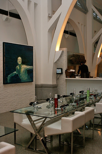 Seating within the noodle bar has modern clear glass tables and hauntingly beautiful paintings of a lady underwater