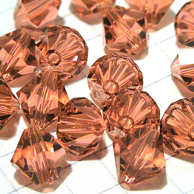 27753012396542 Swarovski Bead - 8 mm Faceted Bicone (5301) - Padparadscha (1)