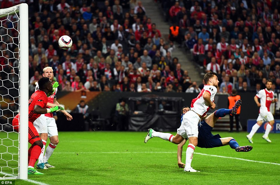 Mkhitaryan looks on as his flicked effort makes its way into the roof of the Ajax goal to put the Red Devils two goals ahead