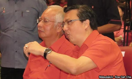 MCA president Liow Tiong Lai whispers in Najib's ear