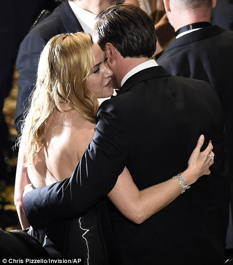 Partner in crime: Kate Winslet was one of the first to congratulate the star before he took the stage to accept his award