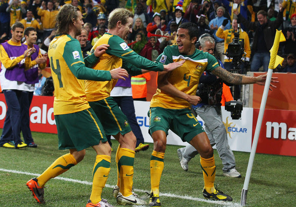 Brett Holman Tim Cahill of Australia celebrates scoring the opening goal with team mates David Carney and Brett Holman during the 2010 FIFA World Cup South Africa Group D match between Australia and Serbia at Mbombela Stadium on June 23, 2010 in Nelspruit, South Africa.
