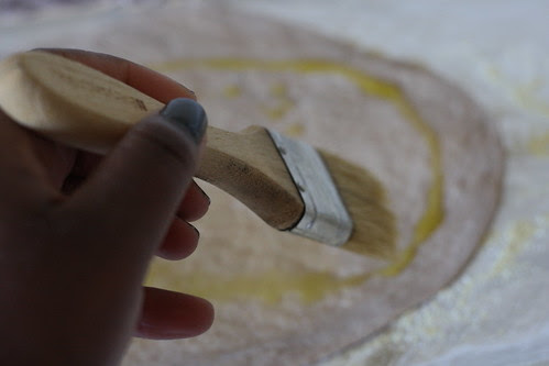 Brush the dough with oil