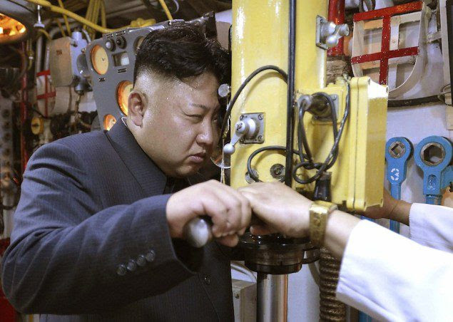 North Korean leader Kim Jong Un looks through a periscope of a submarine during his inspection of the Korean People's Army (KPA) Naval Unit 167 in this undated photo released by North Korea's Korean Central News Agency (KCNA) in Pyongyang June 16, 2014. REUTERS/KCNA