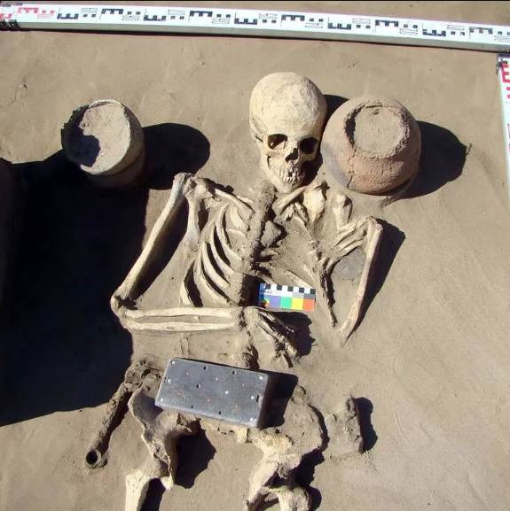 Archaeologists Discover Ancient Skeleton Buried With '2,100 Year Old iPhone'