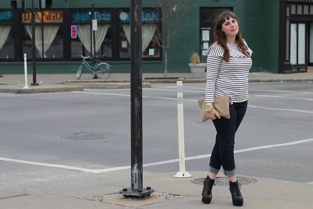 La Marinière outfit: marinière striped top, jeans, Jeffrey Campbell Lita booties, sparkly suede clutch, Noir jewelry dinosaur bone rib cage cuff bracelet, J.Crew pavé cable link bracelet, arty ring, neon bangle