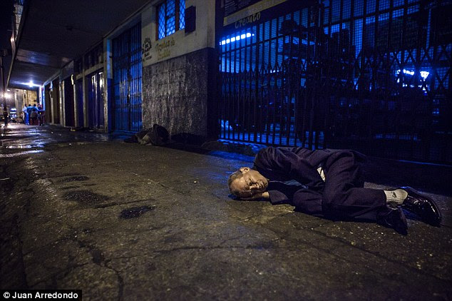 Displaced: With nowhere else to go, this drunk is forced to sleep on the sidewalk