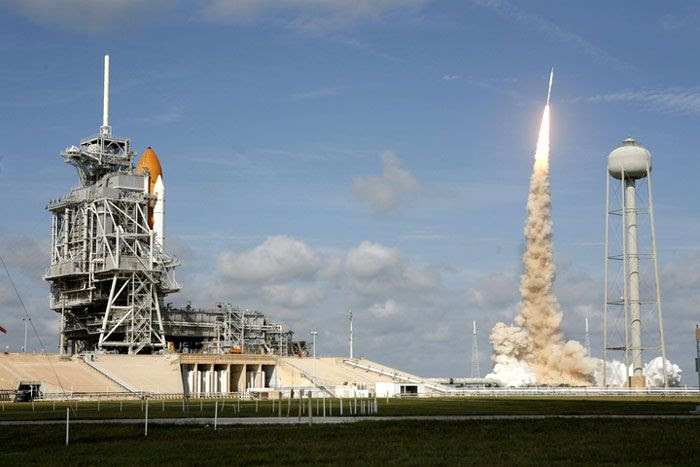 With space shuttle ATLANTIS in the foreground, the ARES I-X rocket successfully lifts off from Launch Complex 39B at NASA's Kennedy Space Center in Florida, on October 28, 2009.