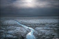 Melted water runs over the Greenlandic Icecap, east to the town of Ilulissat. Some scientists believe that Greenland, with its melting ice caps and disappearing glaciers, is an accurate indication of global warming