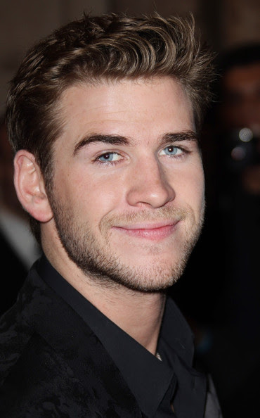 """Liam Hemsworth attends the """"Hunger Games"""" movie premiere, viewed by 1,500 fans at the Gaumont Marignan Cinemas on the prestigious Avenue des Champs Elysees in Paris."""