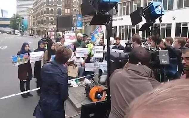 CNN has denied claims it positioned anti-extremism demonstrators behind its cameras to 'create a narrative', insisting the group arrived to be seen by TV cameras