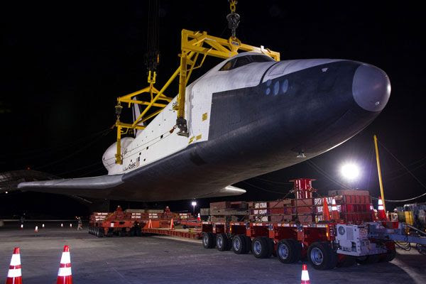 Enterprise is about to be lowered onto a transport vehicle after demating from NASA 905 at JFK International Airport, on May 12, 2012.