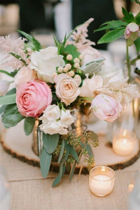 Romantic and rustic centerpiece. A steel mug is the vase
