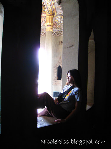posing at window