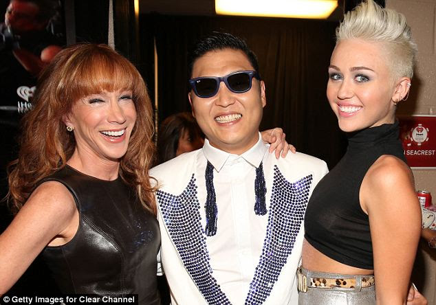 Anti-American? Psy (center) appears with comedian Kathy Griffin (left) and singer Miley Cyrus (right) at the 2012 iHeartRadio Music Festival